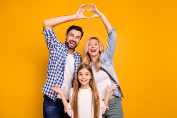 Foto auf Gartenposter Wanddekoration mit eigenen fotos Photo beautiful mom lady handsome dad little school girl daughter showing happy parents celebrate anniversary make heart figure wear casual clothes isolated yellow color background