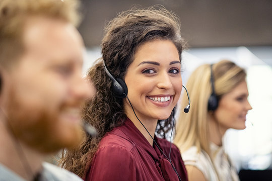 Portrait of smiling woman working in call center