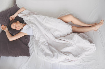 Poster Spa Depressed woman tormented by restless sleep, she is exhausted and suffering from insomnia, bad dreams or nightmares, psychological problems. Inconvenient uncomfortable bed or mattress. Lack of sleep