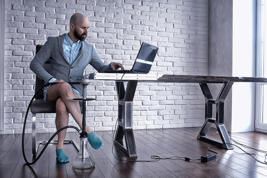 man without pants in working on a computer, laptop, humor coronavirus remote work in underpants