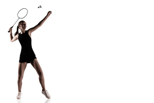 Pretty woman playing badminton over white background