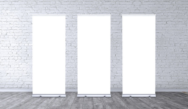 Empty three rollup banners stand. Blank template mockups. Exhibition stand 3 roll-up banners, screen for you design. Vertical white roll up for preview.