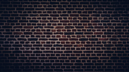 Dark brick wall texture. Rough stone surface. Black or dark gray background
