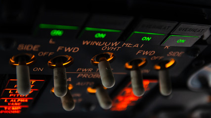 Detailed view of the window heat set of switches in the overhead panel of a large airliner cockpit . Selective focus with beautiful details of modern commercial jet aircraft flight deck Fotobehang