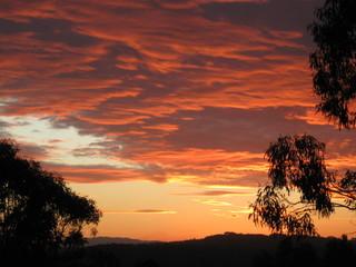 Fototapeten Kastanienbraun Silhouette Of Landscape Against Cloudy Sky