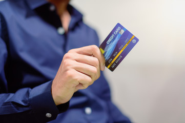 Business people use credit cards to buy, sell, shop, do business