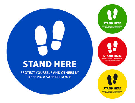 Stand here sign with a footprint for social distancing to stop coronavirus (covid-19)
