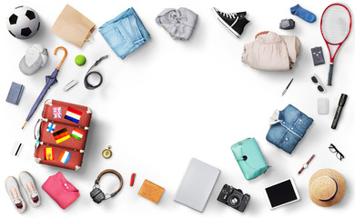 Recreation concept. Suitcase with clothes and accessories for traveling and tourism on a white background