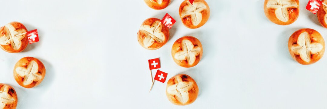 Swiss bread buns  baked in Switzerland to celebrate Swiss National Day. White background, long web banner.
