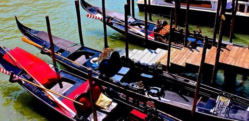 Gondolas Moored On Canal