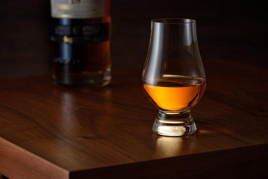 Glencairn whisky on wooden brown table