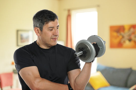 Mature man workingout at home