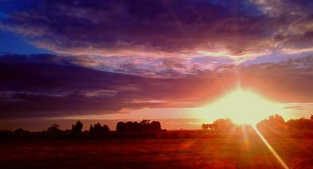 Foto auf Gartenposter Lachs Countryside Landscape At Sunset