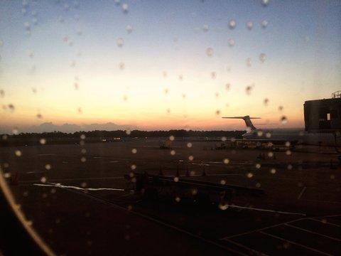 Airport Runway Seen Through Wet Airplane Window