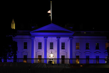 The North Portico of the White House is illuminated in blue in honor of Peace Officers Memorial Day at the White House in Washington