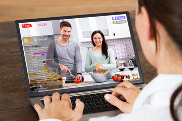 Businesswoman Chatting On Social Website With Laptop