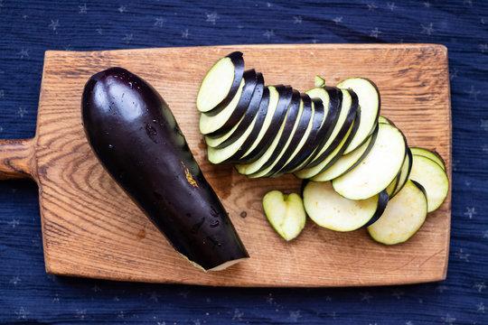 Chopped, cut eggplants or aubergine slices on board.