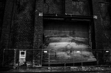Close-up Of Damaged Shutter Of Abandoned Factory
