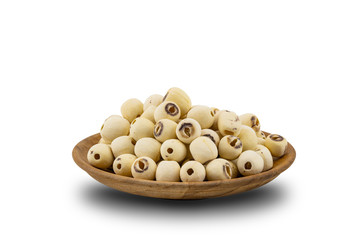 Fototapete - Pile of Dried Lotus Seeds in a wooden plate on white background with clipping path. Nowadays lotus seed become popular healthy food and has highly beneficial for health.