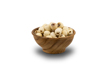 Fototapete - Dried Lotus Seeds in wooden bowl on white background with clipping path. Nowadays lotus seed become popular healthy food and has highly beneficial for health.