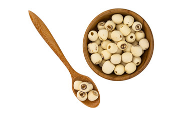 Fototapete - Dried lotus seeds in wooden bowl and wooden spoon on white background with clipping path. Nowadays lotus seed become popular healthy food and has highly beneficial for health.