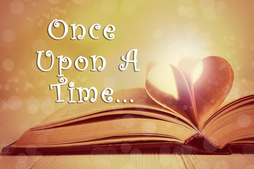 Open book of fairy tales and text Once upon a time