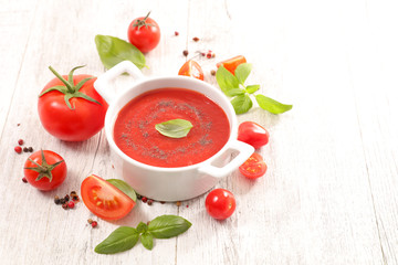 Wall Mural - tomato sauce with basil on wood background