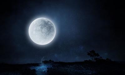Full moon over dark night city