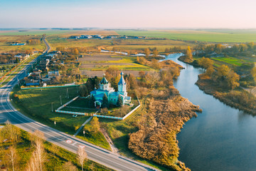 Stores à enrouleur Europe de l Est Krupets, Dobrush District, Gomel Region, Belarus. Aerial View Of Old Wooden Orthodox Church Of The Holy Trinity At Sunny Autumn Day