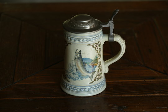 Beer stein with fish painted on side