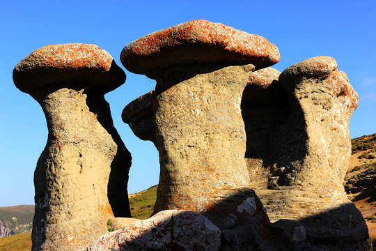 Rock Formations Against Clear Blue Sky At Bucegi Natural Park