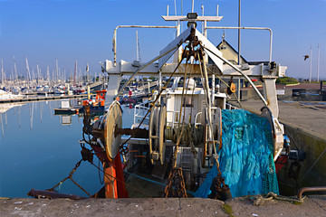 Fishing boat and fishing net seen from behind in the port of Saint-Vaast-la-Hougue, a commune in the peninsula of Cotentin in the Manche department in  Lower Normandy in north-western France