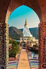 Wall Murals Place of worship Amazing Thailand Temple with big Buddha statue on background scenery nature landscape at sunrise. Beautiful Landmark of Asia, Asian culture and religion.