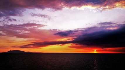 Scenic View Of Dramatic Sky Over Sea - fototapety na wymiar