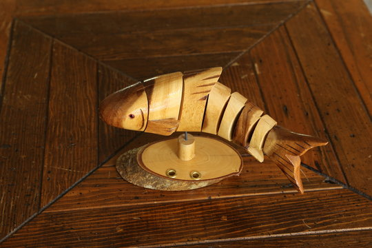 Articulated brown wooden fish
