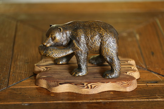 Brown bear desk ornaments on brown stained wood table
