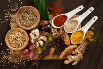 Directly Above Shot Of Various Spices On Cutting Board
