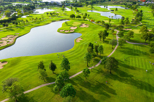 Golf course sport Aerial top view of golf field landscape with sunrise view in the morning shot. Bangkok Thailand
