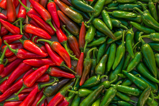Large crop of red and green hot chili peppers
