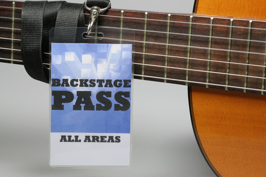 Close-up Of Backstage Pass On Guitar