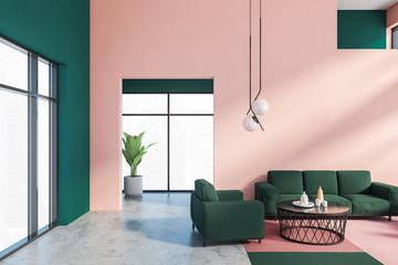 Pink and green living room, sofa and armchair