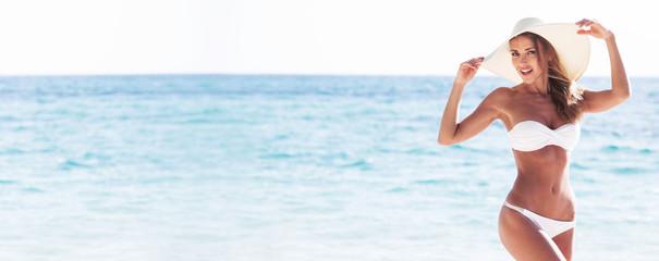Woman in bikini and sun hat