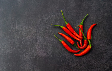 Fotobehang Hot chili peppers red hot chili peppers on black wall background