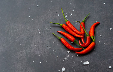 Canvas Prints Hot chili peppers red hot chili peppers with salt on black wall background