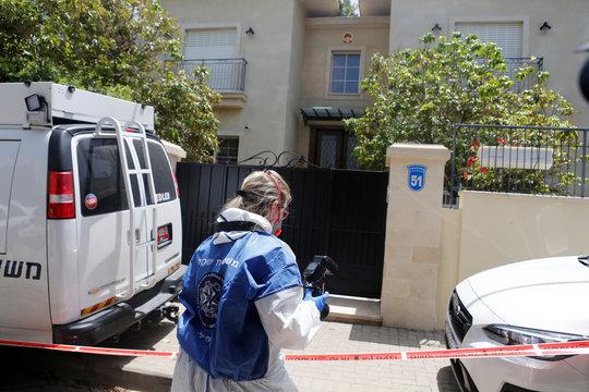 An Israeli police forensic expert holds a camera as she prepares to enter China's ambassador to Israel, Du Wei's house in Herzliya, near Tel Aviv, Israel