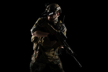 US marine corps soldier with weapon. Shot in studio. isolated with clipping on black background.