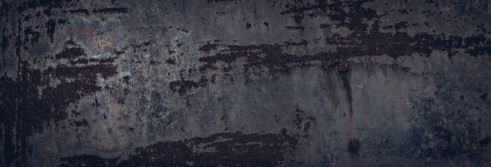 Brutal metal texture for a dark rough background. Some rainbow stains and rust