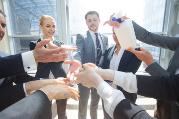 Business people using hand sanitizer