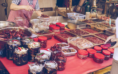 korean side dishes and sauces at the market
