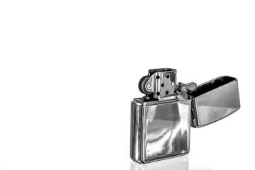 Close-up Of Cigarette Lighter Over White Background